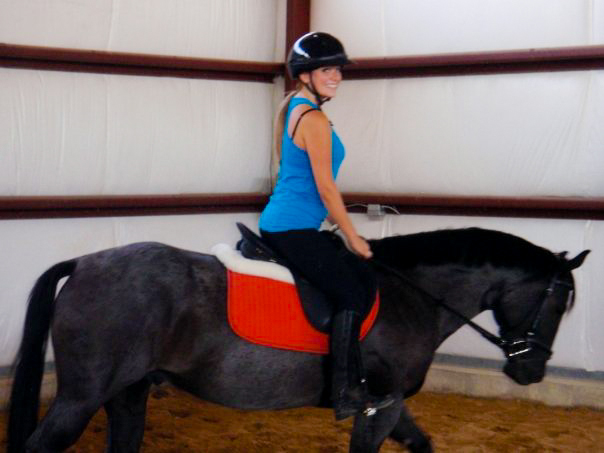 Women indoor horse riding