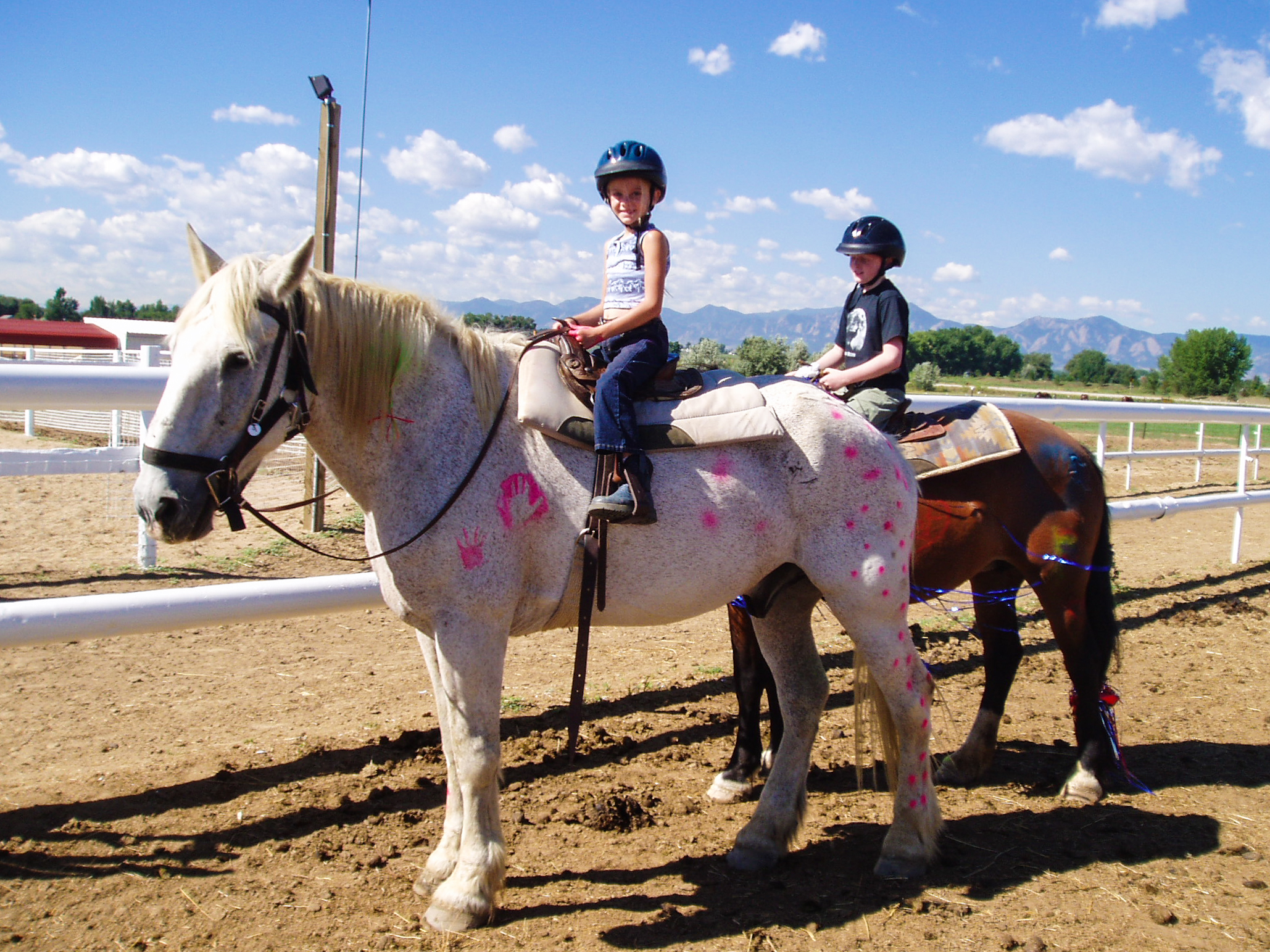 Kids riding painted horses